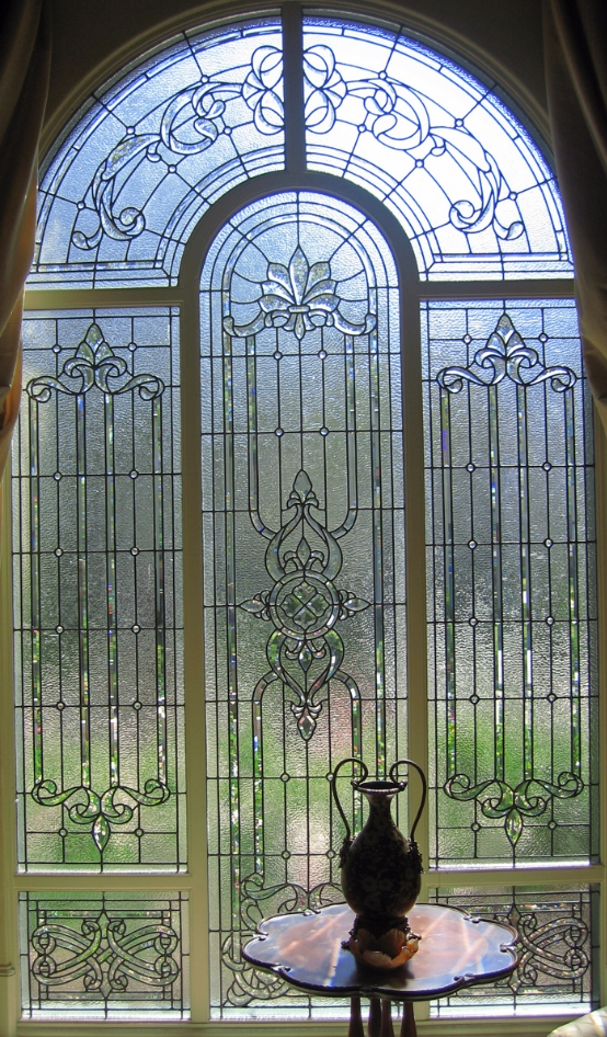 4' x 10' LIVING ROOM WINDOW FACING THE STREET, CLIENT WANTED THE NATURAL LIGHT, BUT NOT THE VIEW. ART GLASS USED A COMBINATION OF CLEAR OBSCURE TEXTURED GLASS AND BEVELS.
