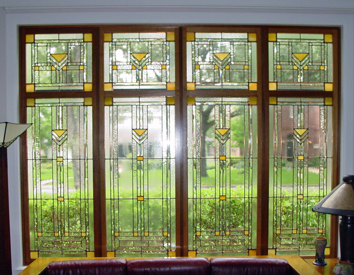 FRANK LLOYD WRIGHT STYLE DESIGN, LEADED ART GLASS PANELS USING COMBINATION OF CLEAR TEXTURES WITH WISPY AMBER ACCENTS, CONSTRUCTED IN COPPER CAMES AND THEN FRAMED IN A LIGHT MAHOGANY FRAMES