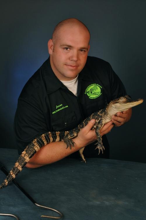 Jason Clark with an alligator (photo by Warren Bond)