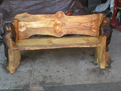 chainsaw carved benches starting at $500.00, chainsawsculpted bear ends