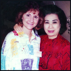 Brenda with Nora Lam on the airplane!