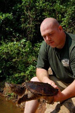 Jason Clark with a burmese python.
